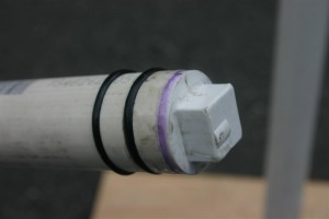 "This is one of the most important details. You can use anything convenient to cap the end of the 1"" diameter PVC interior piston.  A large dowel would work, too.  I just happened to find a miscellaneous piece of round PVC that fit nicely.  I used a table saw to cut channels for the O-Rings.  It's a very snug fit."